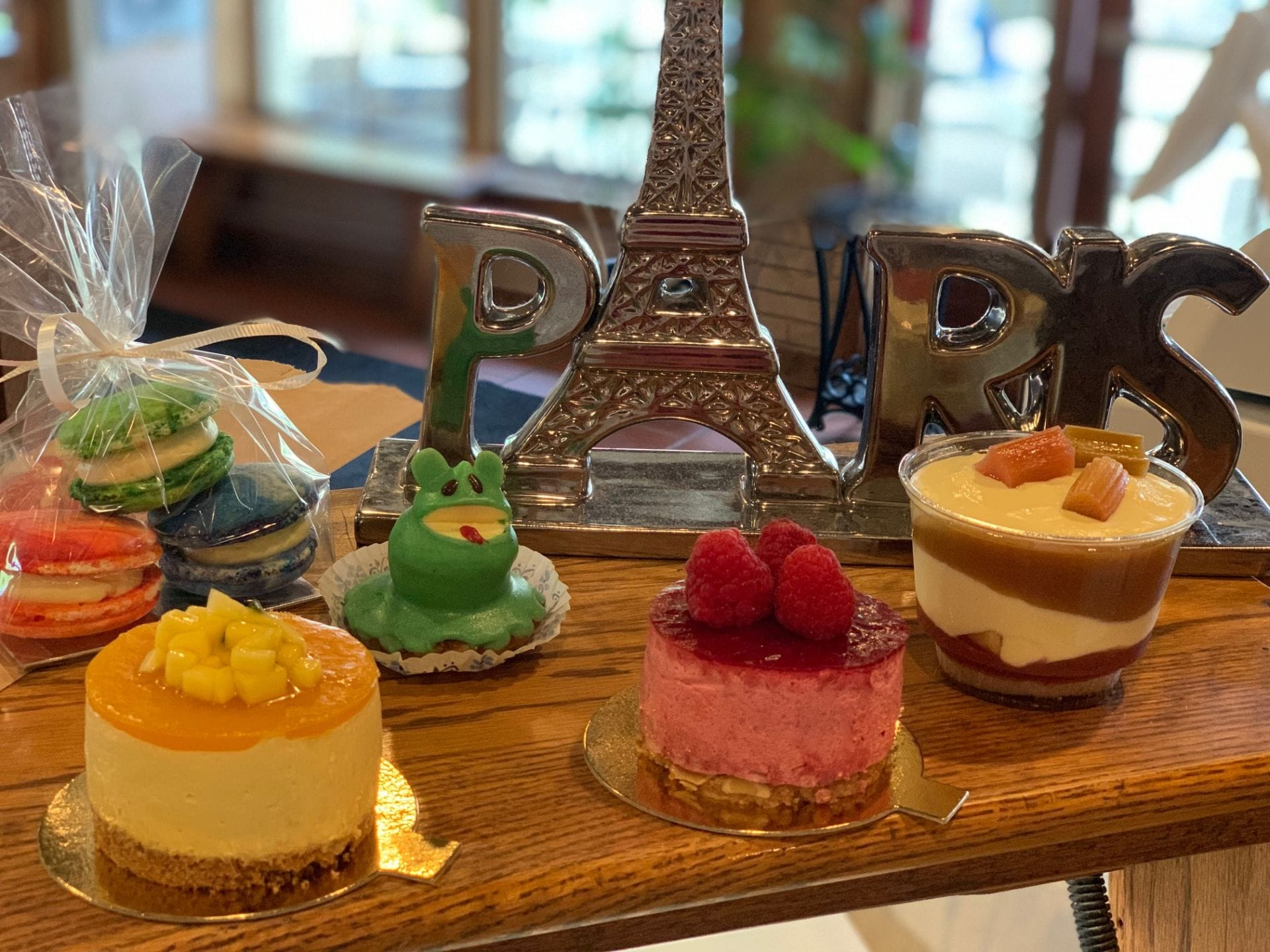 miniature eifel tower on a table with pastries