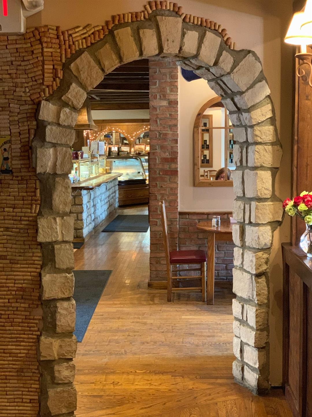 Brick archway entrance into dining room