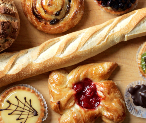 assortment of pastries with a loaf of bread