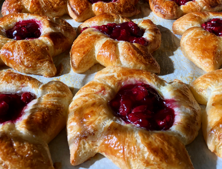 Cherry pinwheel croissants on a tray