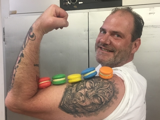 Employee with Macaroons displayed on his bicep