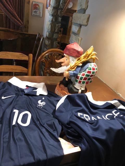 France jerseys on a table with a gnome