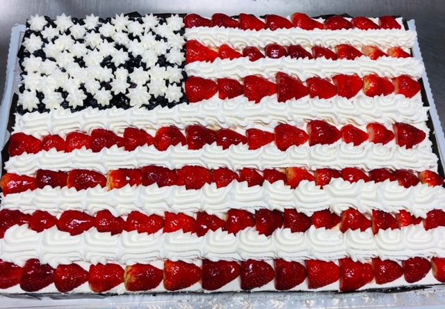 strawberries and blueberries in the shape of an American flag