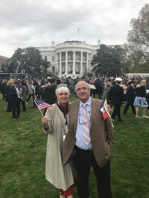 man and woman posing for a photo in front of the white house