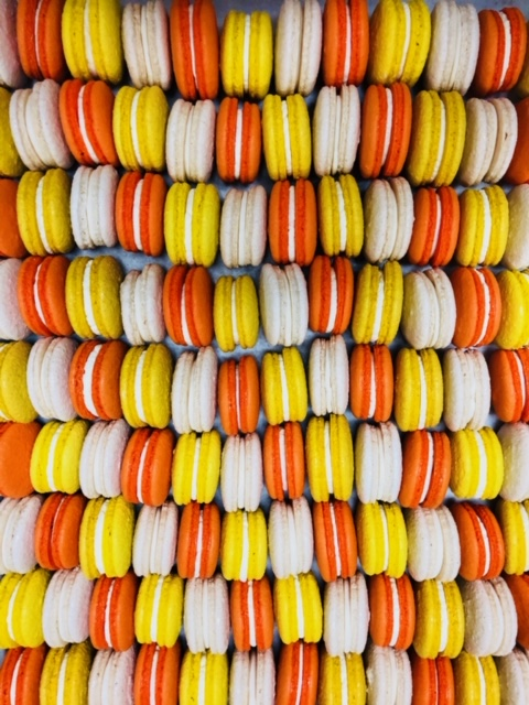 Assortment of flavored macaroons on a tray