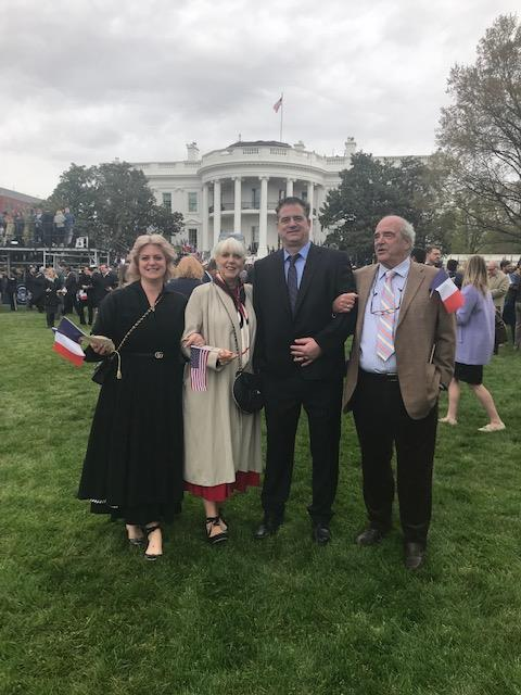 family posing for a photo in front of the white house