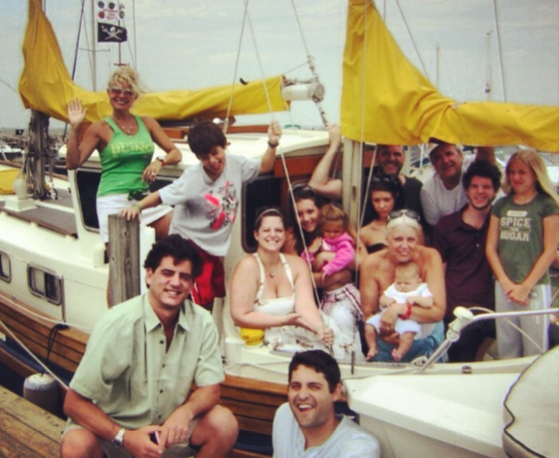 family posing for a picture on a boat