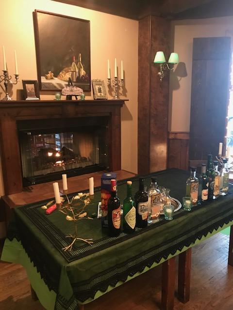 table with an assortment of alcoholic drinks