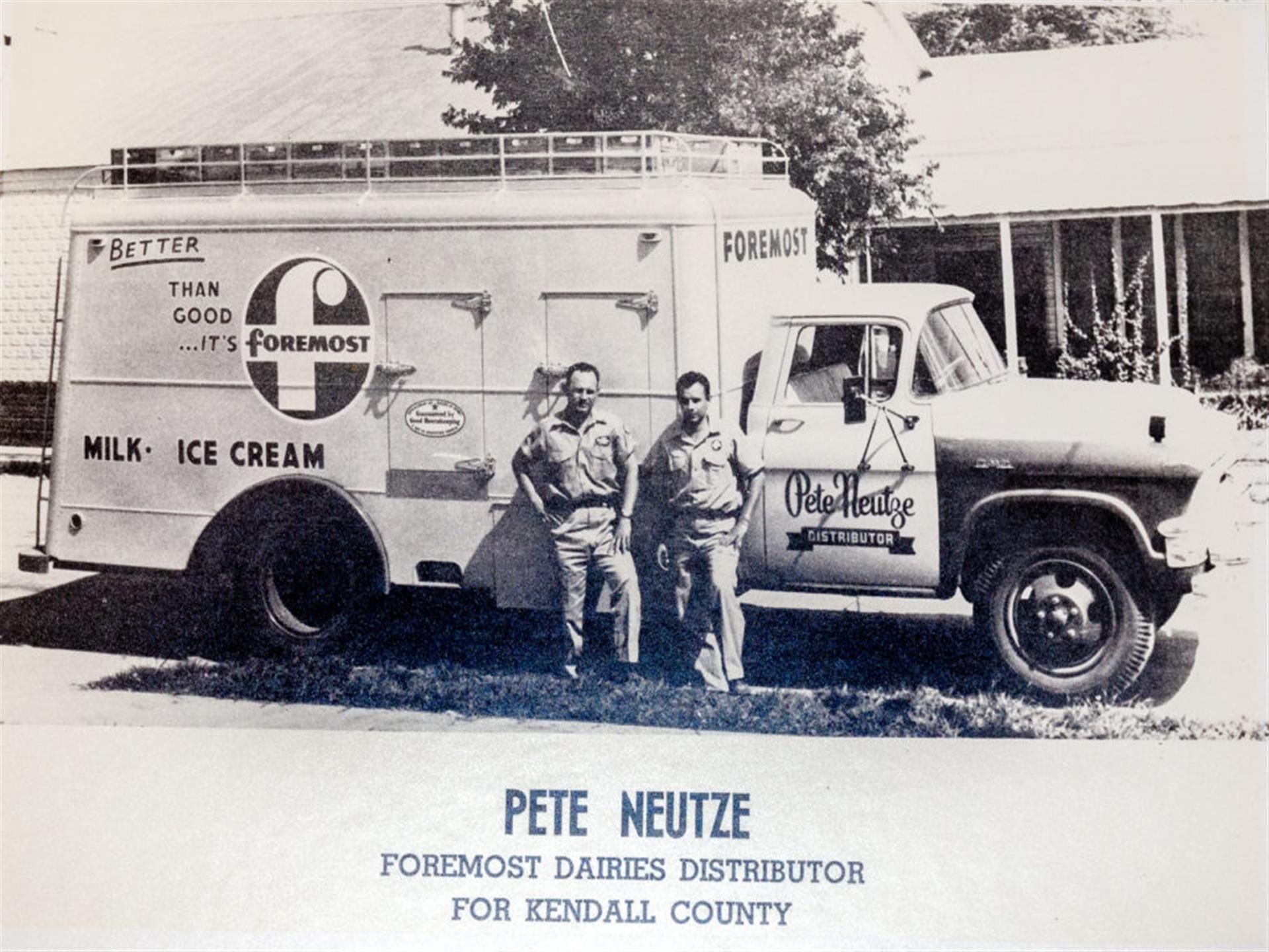 vintage photo of pete neutze standing in front of foremost dairies distributor truck