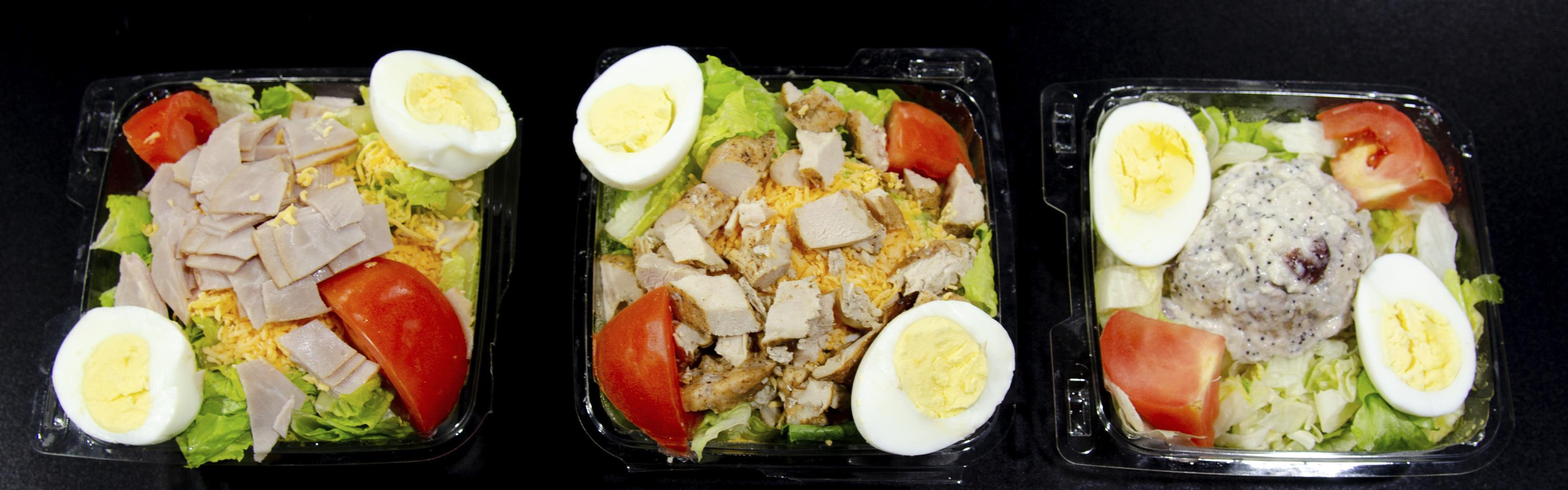 three salads with different kinds of meat and hard boiled eggs
