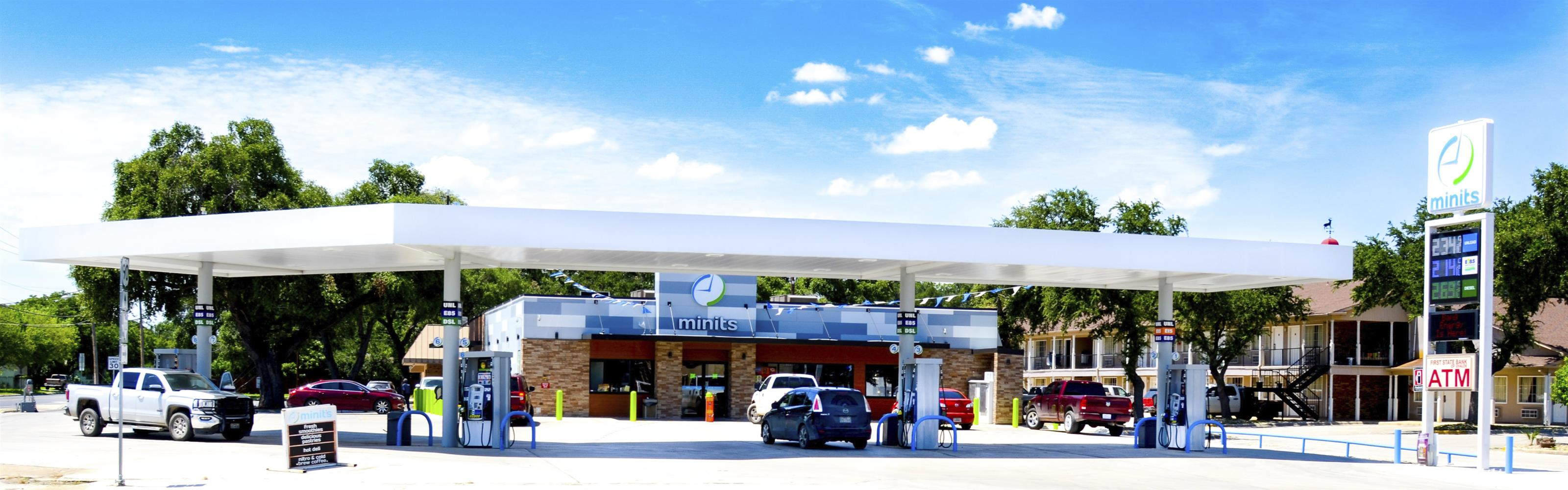 the gas station outside of the minits shopping center