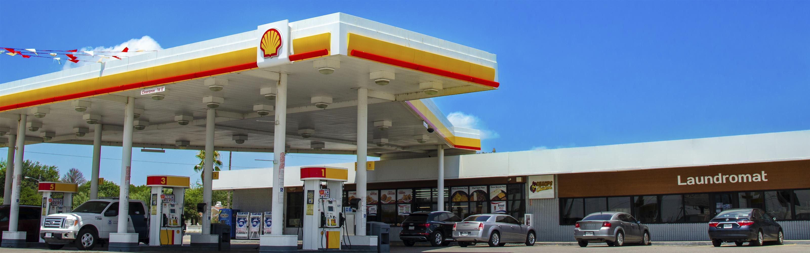 shell gas station in front of the laundromat