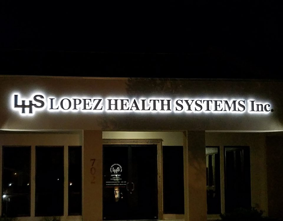 outdoor signage installed on a building for lopez health systems inc.