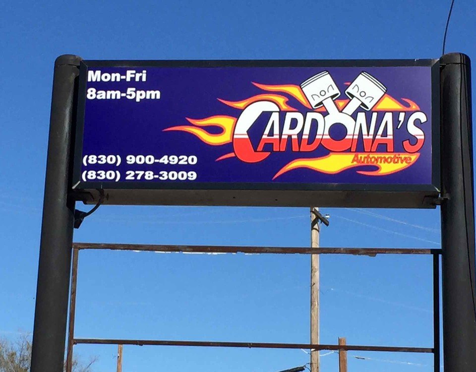 large signage outdoors for cardona's automotive