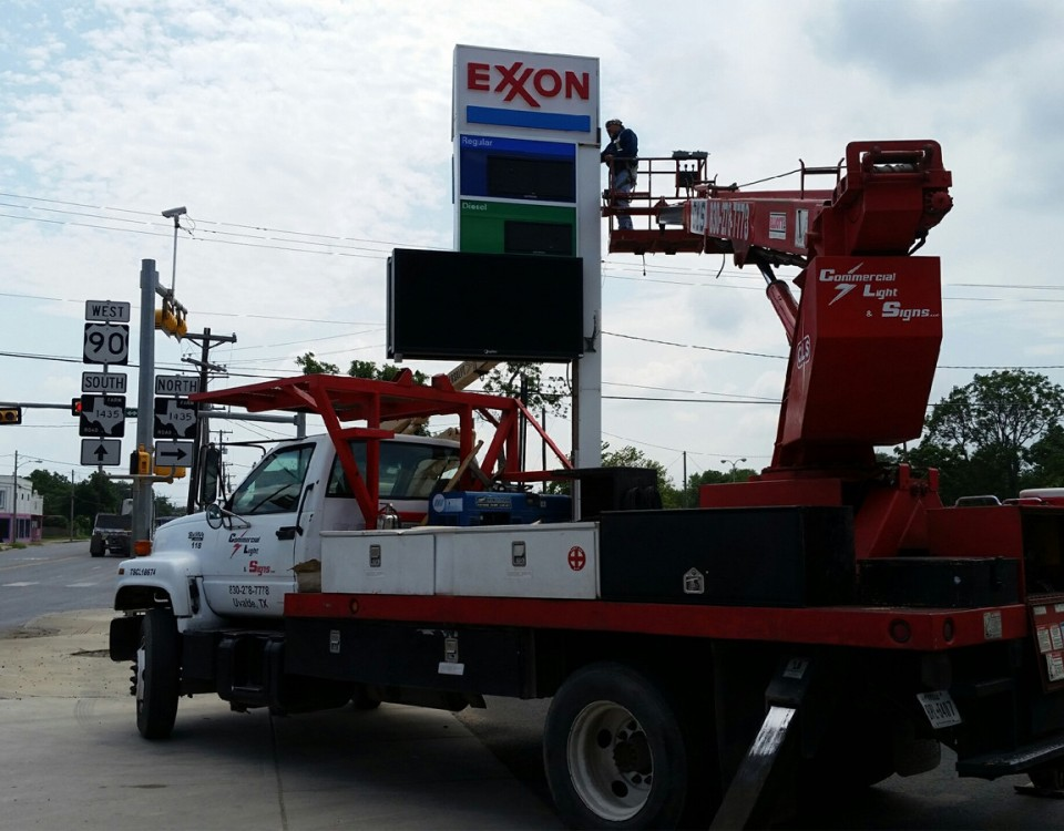 exxon sign being installed