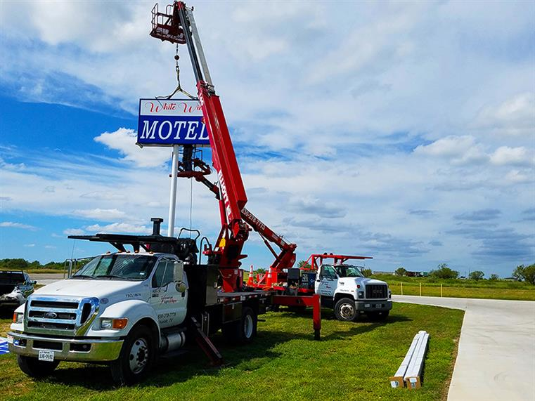 Machine instaling a new sign for a local Motel