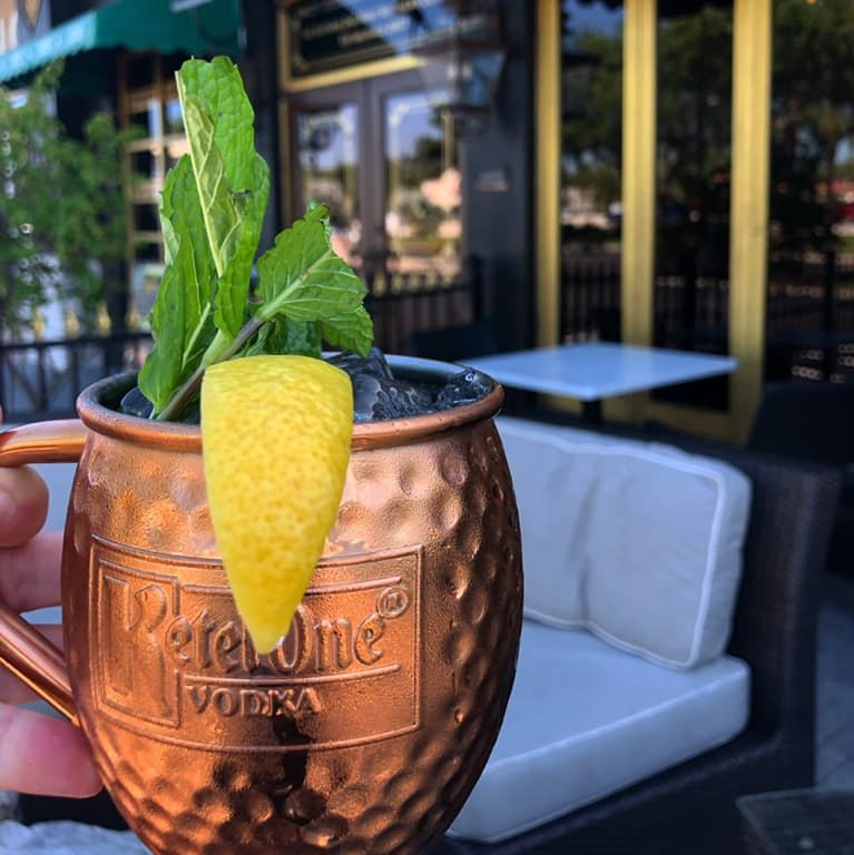 Moscow mule in a copper mug with lemon and mint