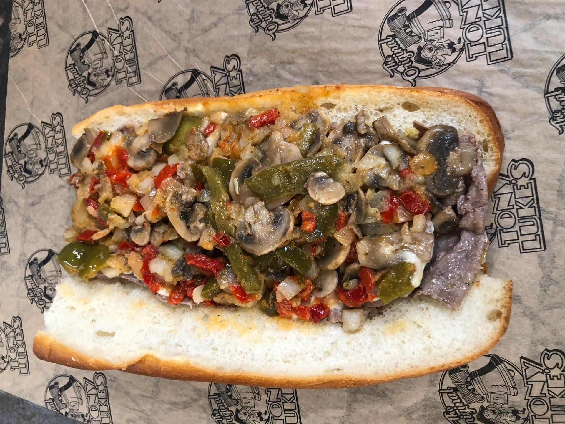 Philly Cheesesteak with mushrooms, sausage, and peppers