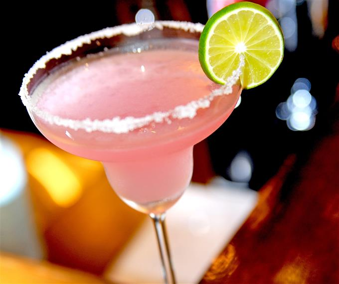 a pink margarita with lime