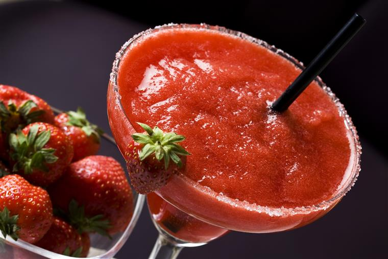 a strawberry daiquiri, pictured with extra strawberries