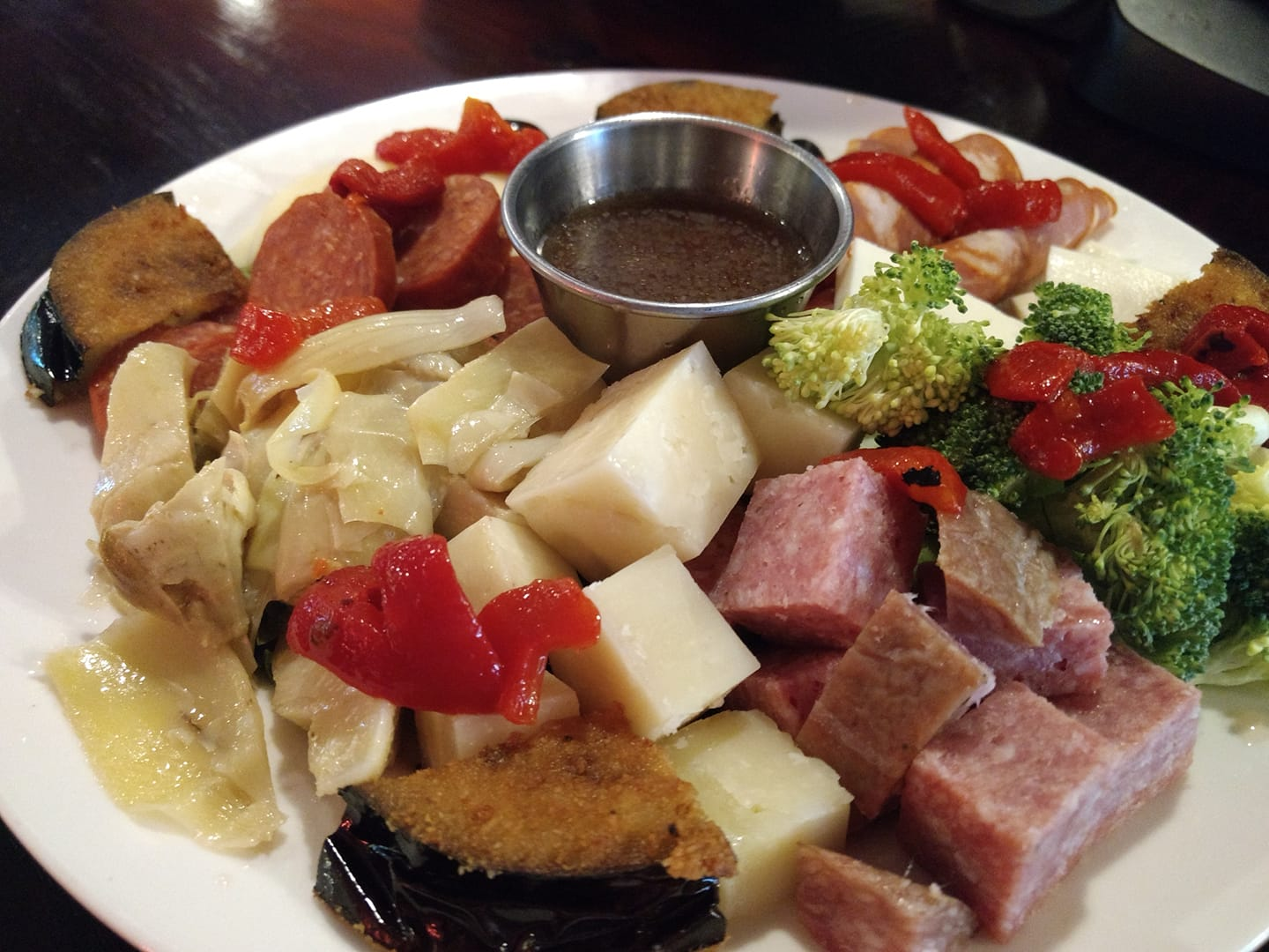 antipasto salad with italian meats and cheeses served with olives and vegetables
