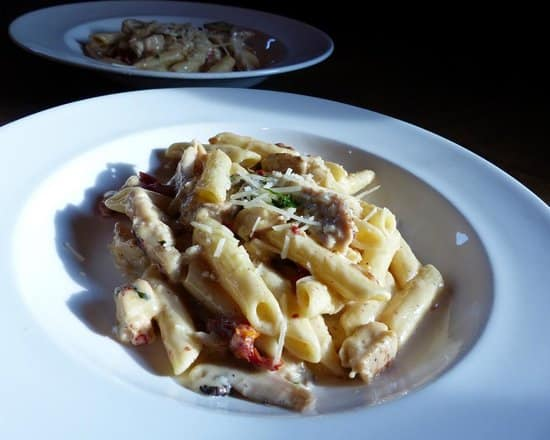 Penne pasta in alfredo sauce with chicken