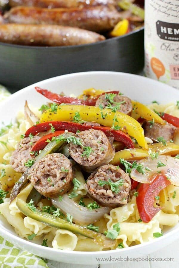 Pasta with sausage and red and yellow peppers and onions