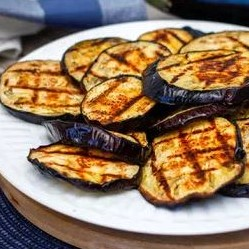 grilled eggplant discs on a table outside