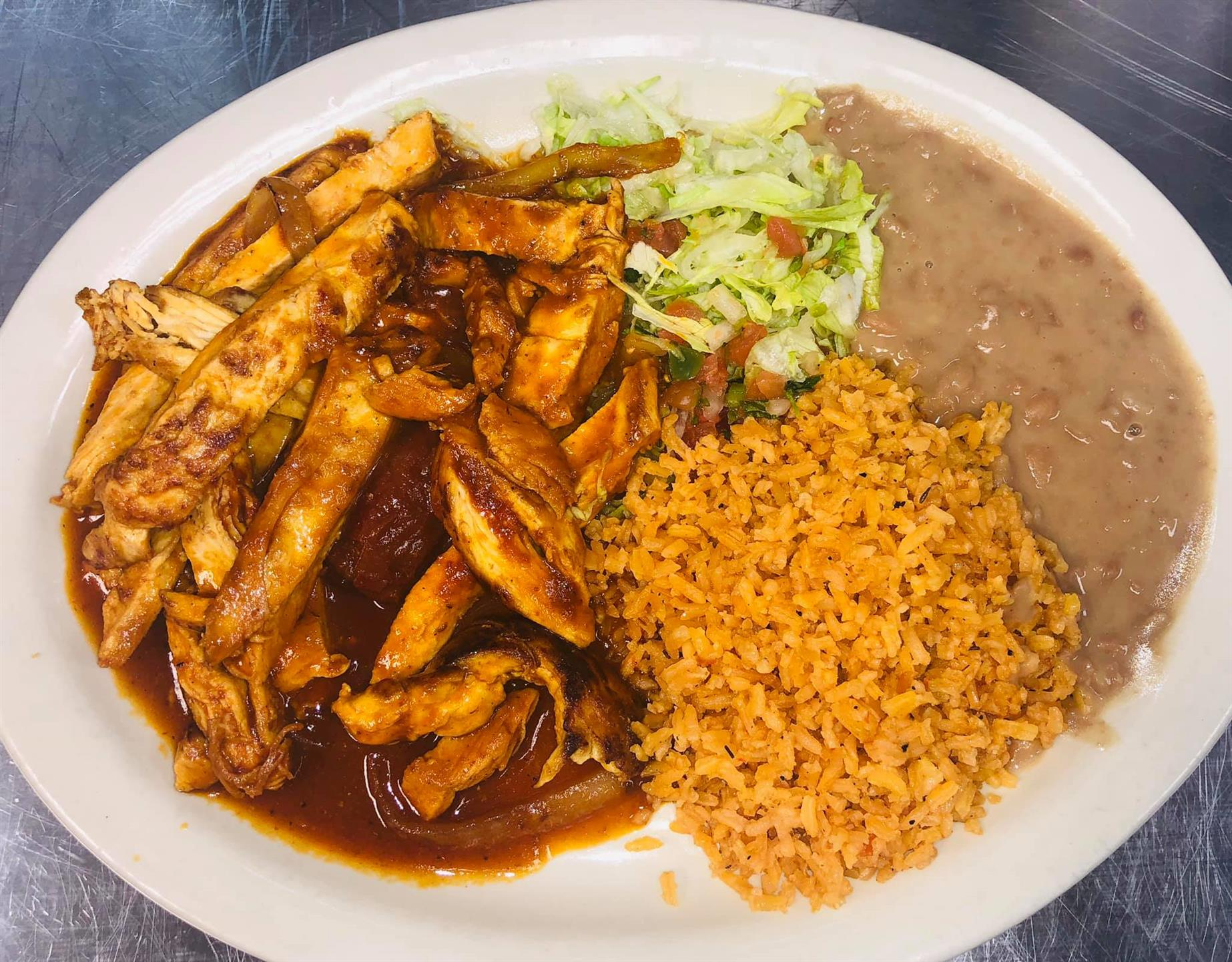 Chipotle chicken with rice and beans on a plate