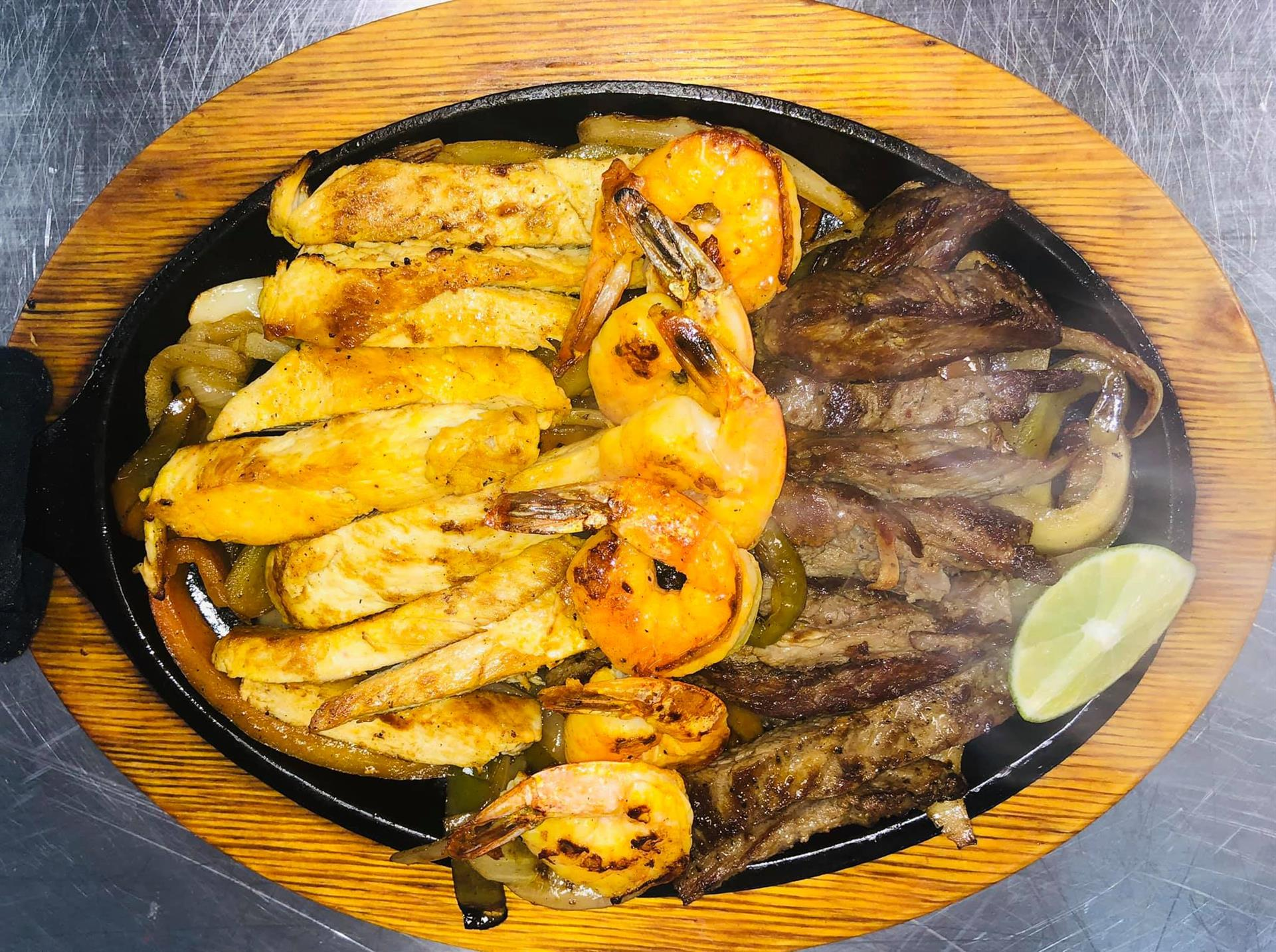 Mixed fajita platter on a skillet