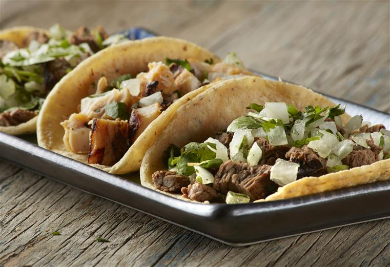 Street tacos with chicken and beef, cilantro and onion