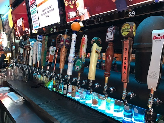 various beer taps located behind the bar