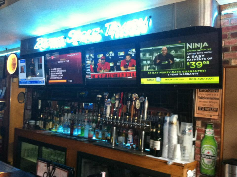 interior bar area with tvs hanging above