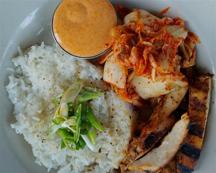 Grilled chicken, crab, and white rice with a side of cream sauce