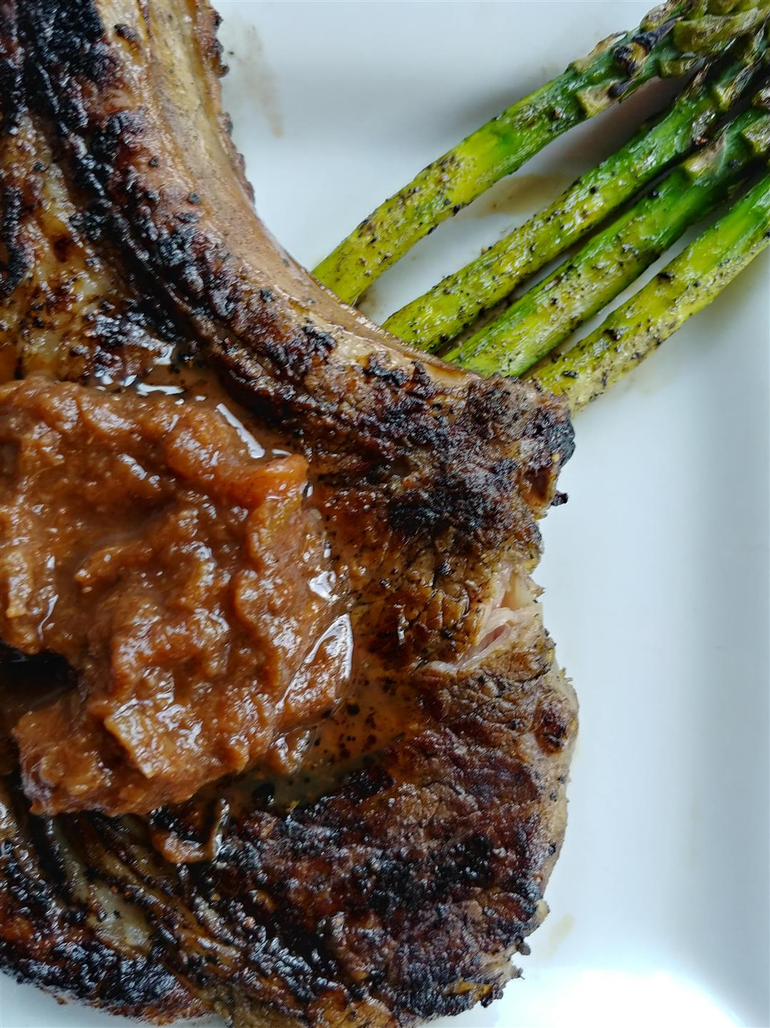 Grilled steak with a side of grilled asparagus