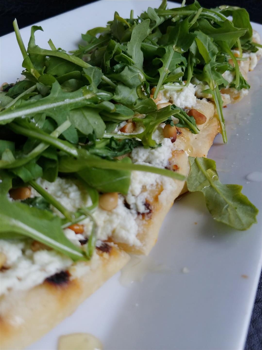 Fig and Prosciuto Flatbread on a plate