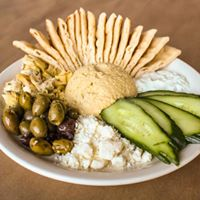 hummus plate which includes hummus, olives, feta cheese, artichokes, cucumbers, tatziki & pita bread