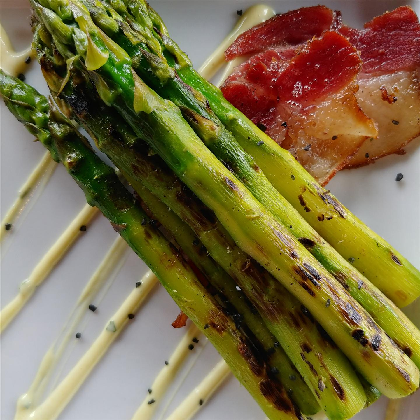 grilled asparagus drizzled in a cream sauce