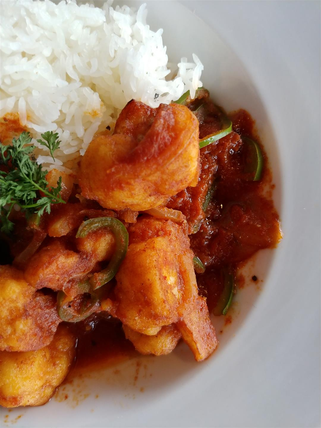 shrimp in a sauce and white rice