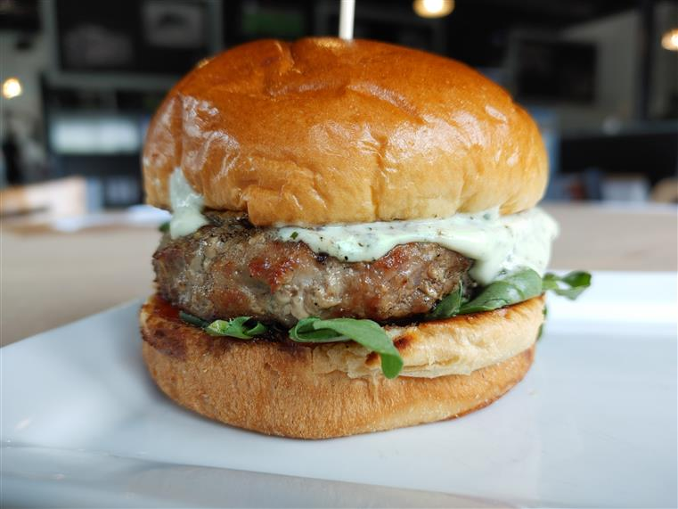 burger with sauce and arugula