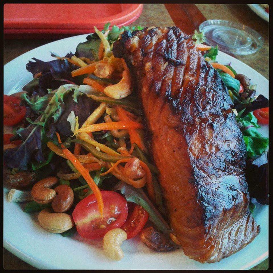 Grilled salmon on a spring mix salad
