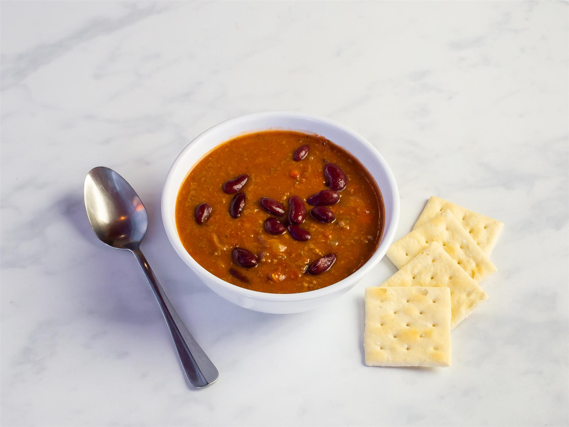 beef chili in a bowl with crackers