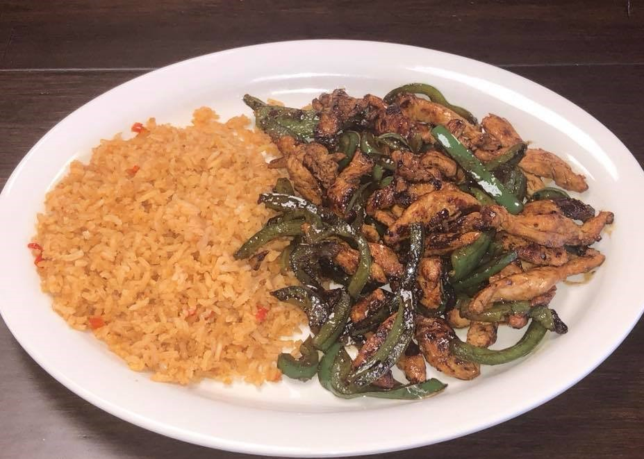 Chicken fajita on a plate with rice