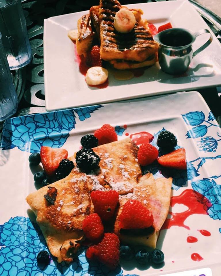 pancakes and crepes with chopped fruit and powdered sugar
