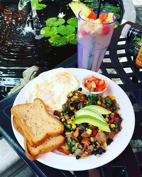 eggs over easy with beans, corn, avocado slices and toast