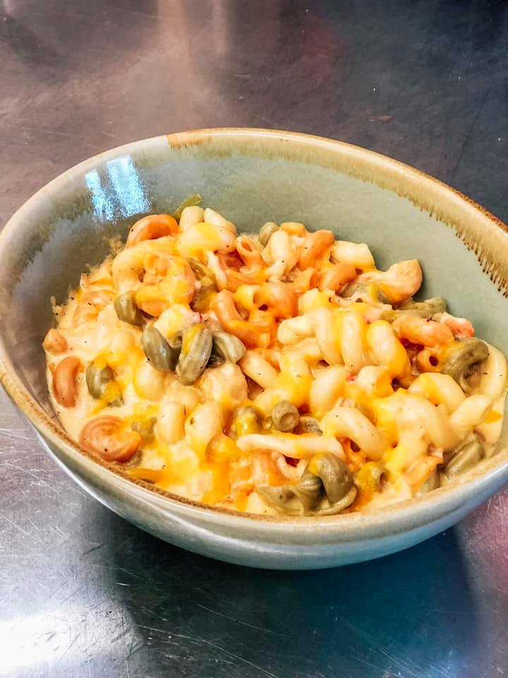 lobster cream sauce over cavatappi pasta topped with lobster chunks