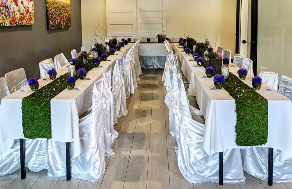 Table covered in cloth and decorated for party