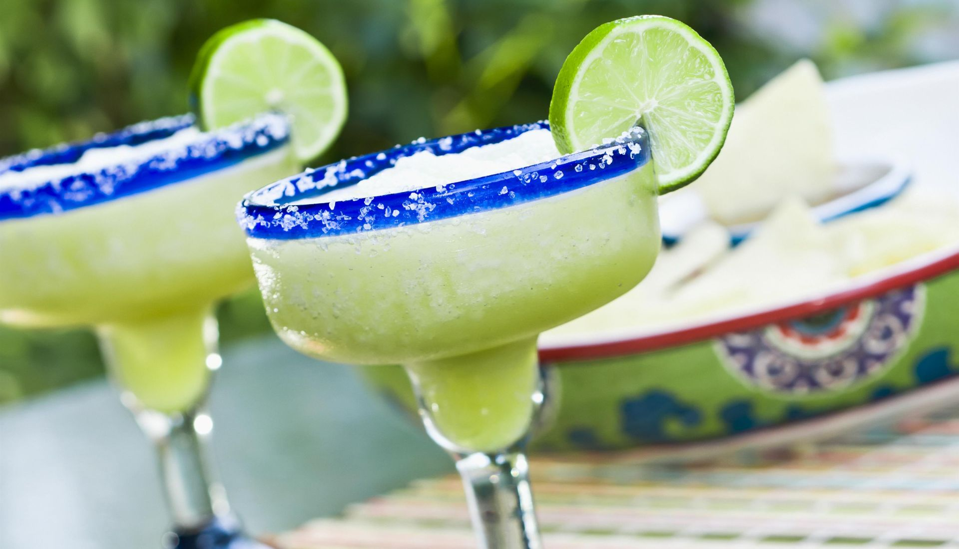 Margaritas in glasses with a lime and salted rim