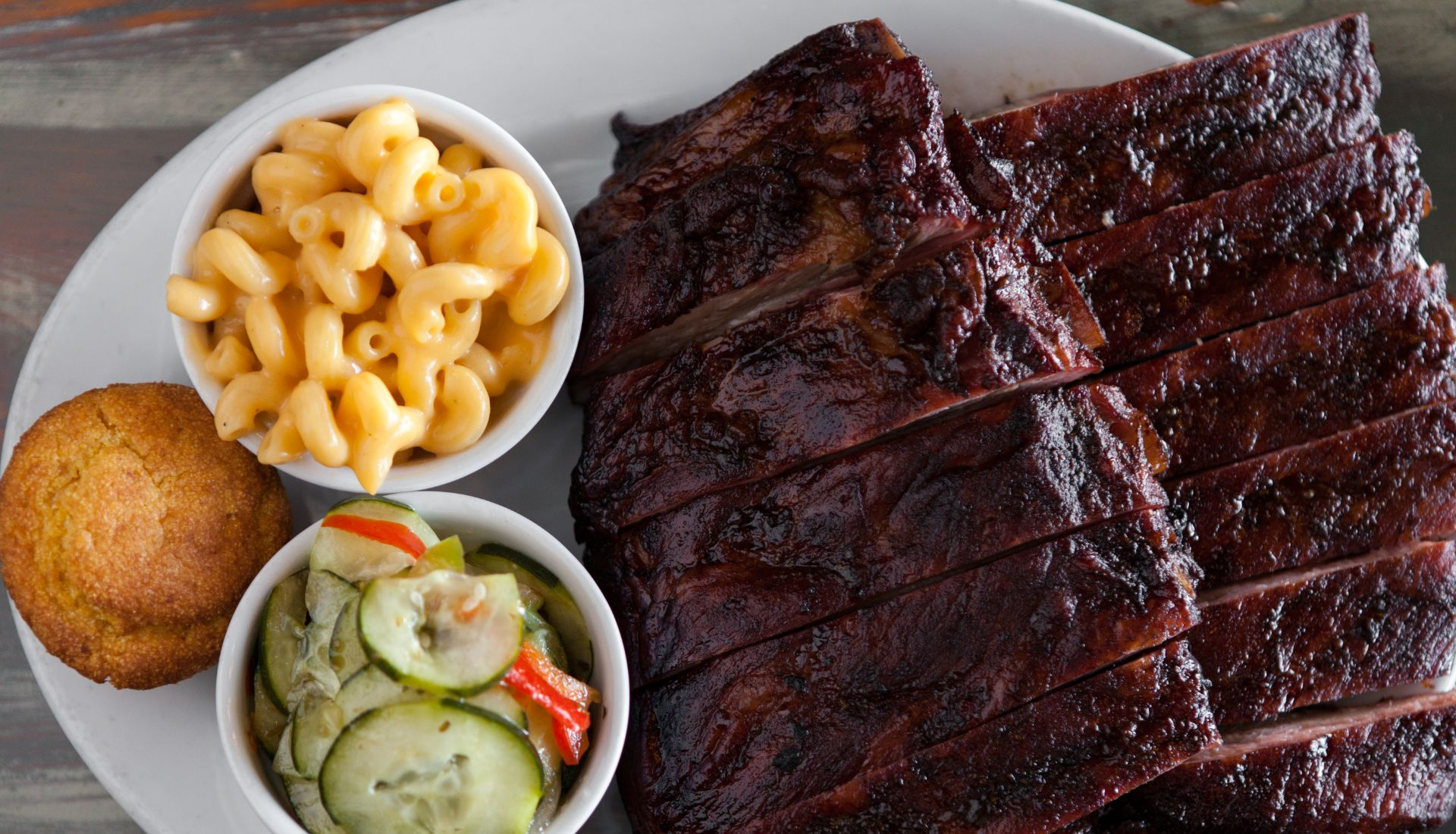 BBQ ribs on a plate with pickled vegetables and mac and cheese