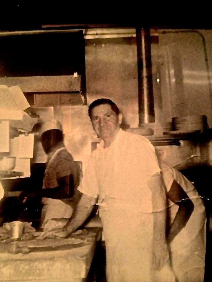 Man working in the kitchen of Nappoli VIlla